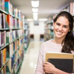 In the library - pretty female student with books